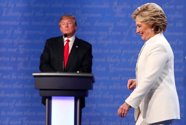 Democratic U.S. presidential nominee Hillary Clinton walks off the debate stage as Republican U.S. presidential nominee Donald Trump remains at his podium after the conclusion of their third and final 2016 presidential campaign debate at UNLV in Las Vegas, Nevada, U.S., October 19, 2016. REUTERS/Rick Wilking