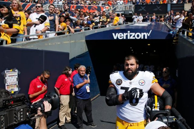 CHICAGO, IL - SEPTEMBER 24: Alejandro Villanueva #78 of the Pittsburgh Steelers stands by himself in the team's tunnel during the national anthem prior to a game against the Chicago Bears at Soldier Field on September 24, 2017 in Chicago, Illinois. Villanueva, a former Army Ranger who served terms in Afghanistan, was the lone Steeler to appear during the anthem. The Bears won 23-17 in overtime. (Photo by Joe Robbins/Getty Images)