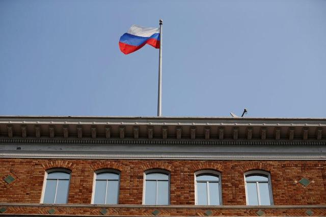 The Russian flag waves in the wind on the rooftop of the Consulate General of Russia in San Francisco, California, U.S., September 2, 2017. REUTERS/Stephen Lam