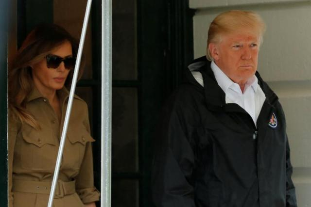 U.S. President Donald Trump and first lady Melania Trump walk out from the White House in Washington before their departure to view storm damage in Texas, U.S., September 2, 2017. REUTERS/Yuri Gripas