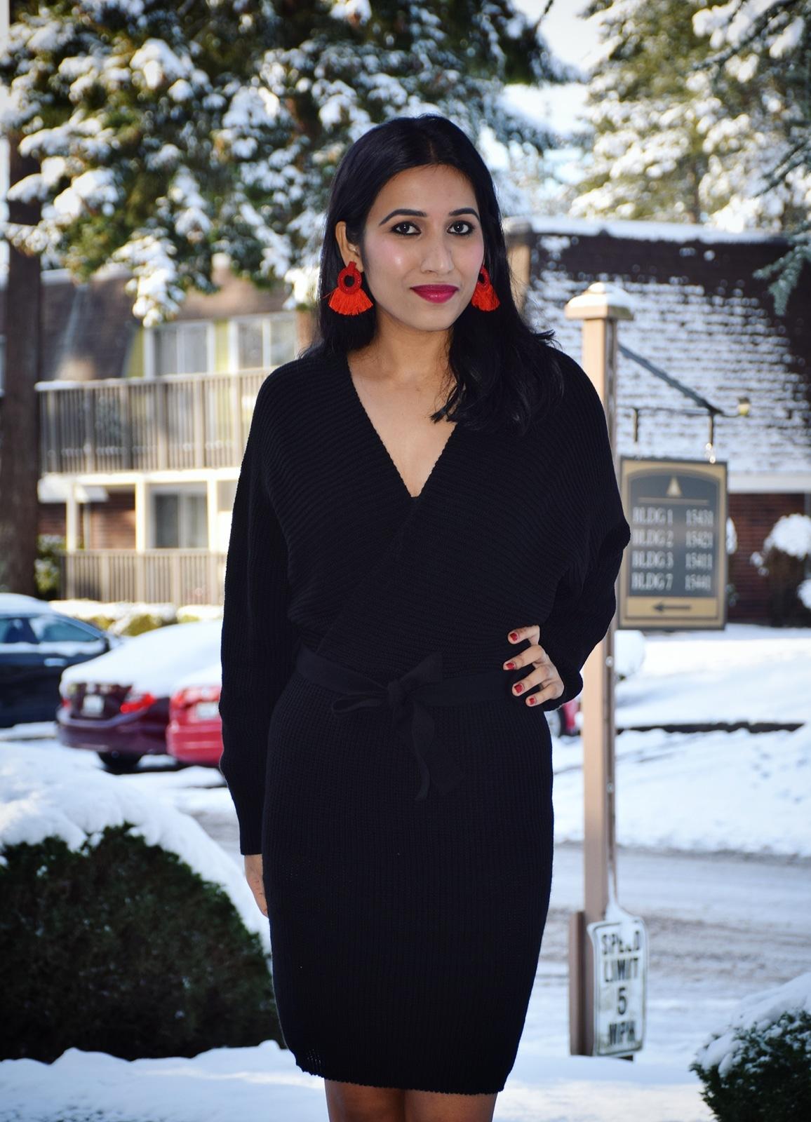https://femmeluxefinery.co.uk/products/black-knit-long-sleeve-tie-front-wrap-dress-star