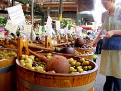 Selling olives at the Borough Market in London - Quirky Things to Do in London