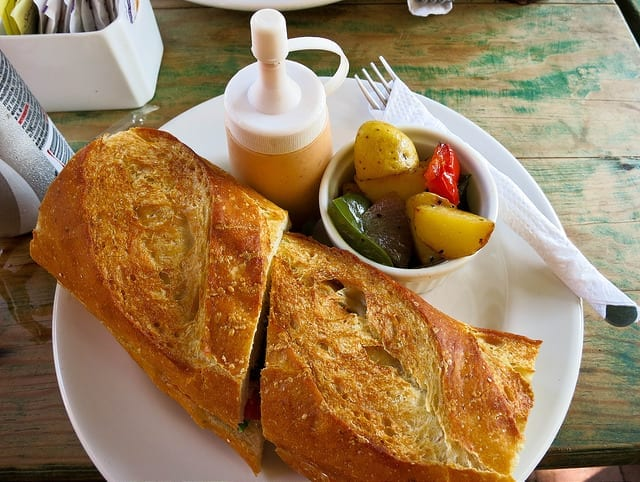 Sandwich with a side of potatoes in Sayulita - The Best Non-Mexican Sayulita Restaurants