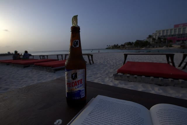 A Tecate Light Beer with a Lime on the Beach - How to Travel Slow on a Short Trip