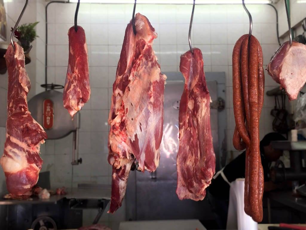 Raw Beef Hanging at the Market in Cancun