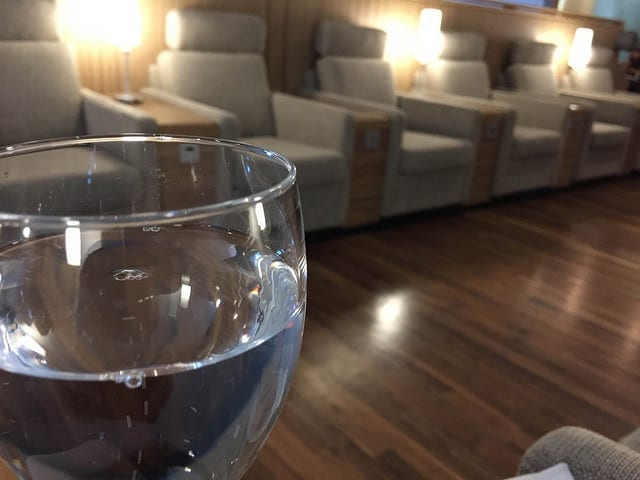 A Glass of Sparkling Water in the IcelandAir Lounge - What Travel During First Trimester is Like
