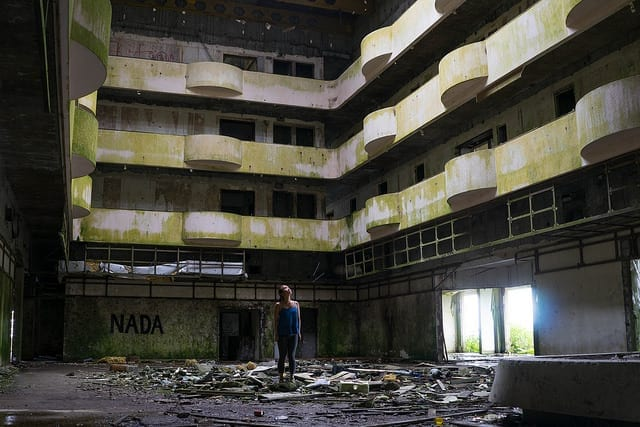 A Woman in An Empty Abandoned Building - Don't Quit Your Job to Travel