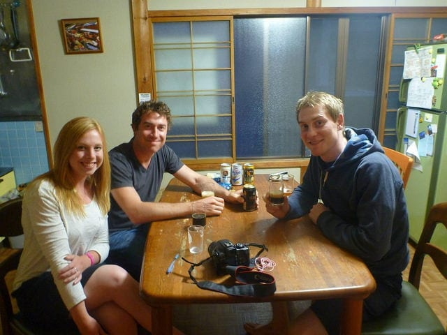 Myself and my Husband Making Friends at the Hostel - How to Meet People While Traveling As a Couple