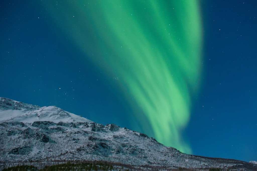 Northern Lights Over a Snowy Mountain - A Winter Trip to Norway