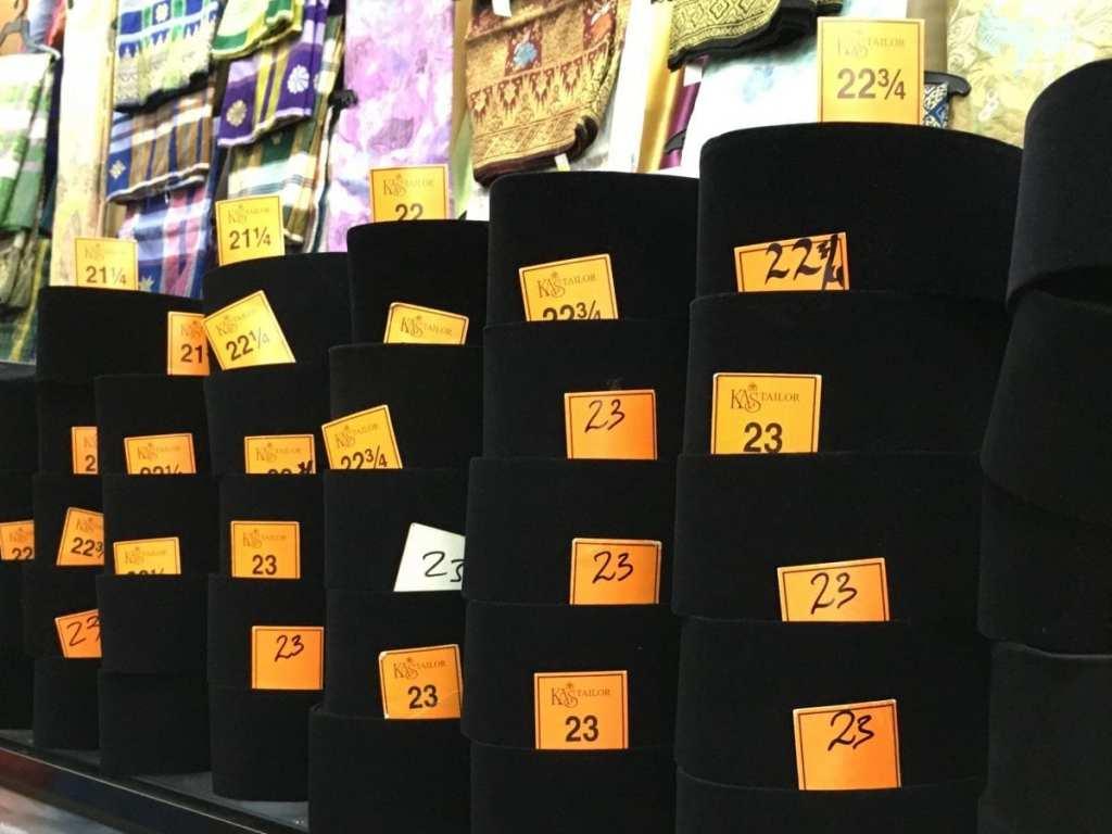 Pill box hats for sale at the Ramadan market in Kuala Lumpur