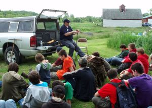 Photo by Lt. Col. Larry Ochowski - Maj. David Deiler teaches the boy scouts about the L-Per used during a search and rescue mission.