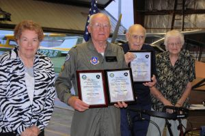 Photo by Sr. Member Julie Nicholds - Major Clement Dahlke and his wife and retired CAP member, Warren Baumgart with his wife, after receiving their FAA awards for Master Pilot.