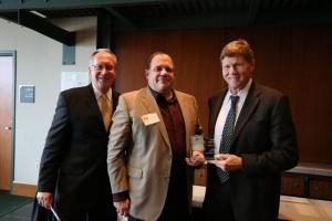 Major Todd Mandel receives his award from Mike Murphy, Packers President & CEO, and Jerry Ganoni, retired President of Humana's Commercial Insurance Division. Photo credit: Matt Becker, Packers.com