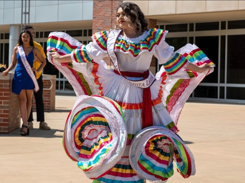 Carla Garza, a senior at Wichita East High School, demonstrates a Mexican folk dance during the Latine Heritage Month Celebration at Wichita State University on Sept. 15.