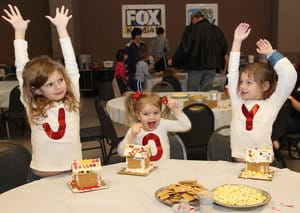 Kids spelling out J-O-Y at Gingerbread Village in Wichita