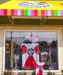 local store with open sign and wichita flag in the window