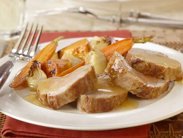 Roasted pork tenderloin with apple ginger sauce and roasted root vegetables