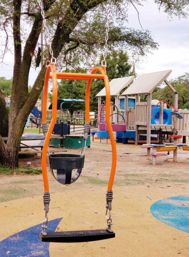 expression swing for parent and baby at Sunrise Boundless Playscape Sedgwick County Park Wichita KS