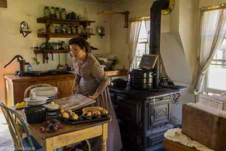 Prairie woman baking in kitchen at historic Old Cowtown Museum - photo by Jay Stockhause