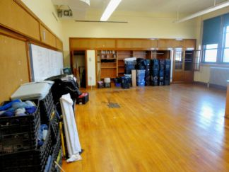 Looking to the left, across the mostly-empty room to the shelving.