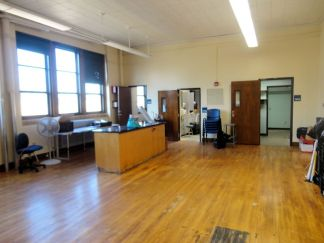 Looking to the right, the former science room has smaller rooms, some with sinks!