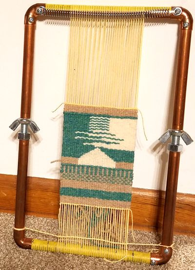 Small tapestry weaving on the loom