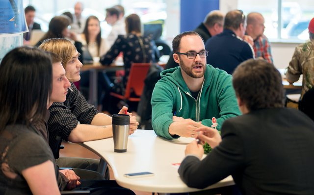 Software engineer Jon O'Donnell of Introhive mentors the team from Harbour View High. (Michael Hawkins/Wicked Ideas)