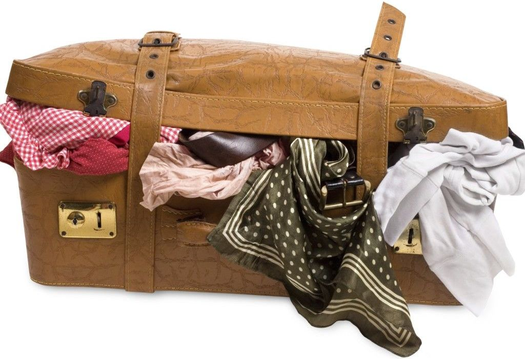 suitcase with clothing spilling out