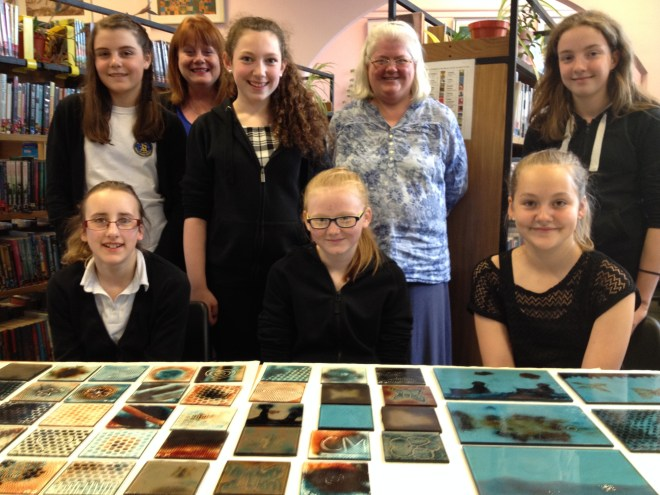 The staff and pupils involved with their artwork.