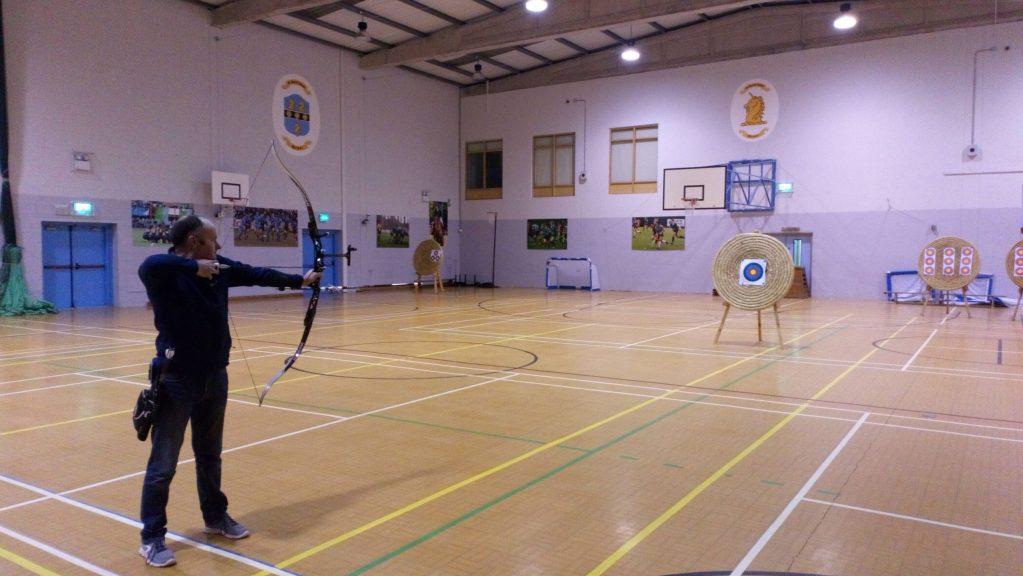Recurve Archer shooting indoors at St. Gerards School