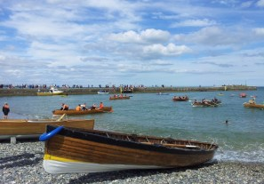 Boats reach the beach after a race during Wicklow Regatta at Wicklow Rowing Club
