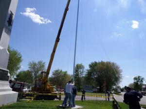 Fall River veterans and volunteers are seen erecting a historic flag pole at the Fall River Cemetery on May 25th, 2015