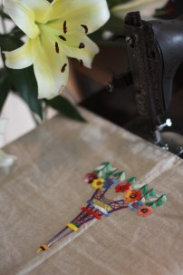 Table runner wls wtr001 - SOLD Material : linen Colour : beige with 4 blue tassels Length : 130cm Width : 33cm