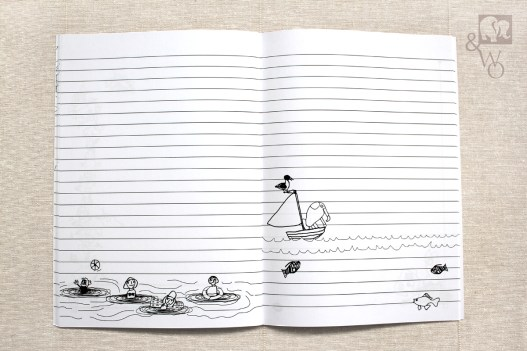 an illustrated black and white lined A6 notebook