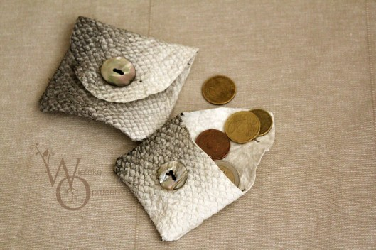 two small fishleather wallets with mother of pearl buttons