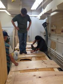 Wayne and crew flattening pieces of side-panel birchbark at the wood shop in UW-Madison (Photo Credit: Marcus Cederström)
