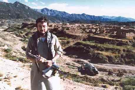 Jamal Khashoggi holding an assault rifle