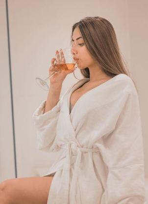 Anicka drinking wine
