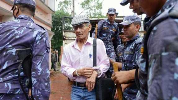 Charles Sobhraj being escorted to his hearing in Nepal
