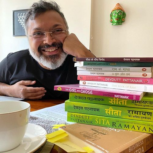 Devdutt Pattanaik displaying his books