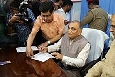Anup Chandra Pandey signing some documents after becoming Chief Secretary of UP in 2019