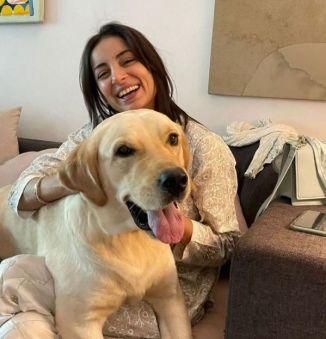 Sarwat Gilani cuddling with her dog Leo