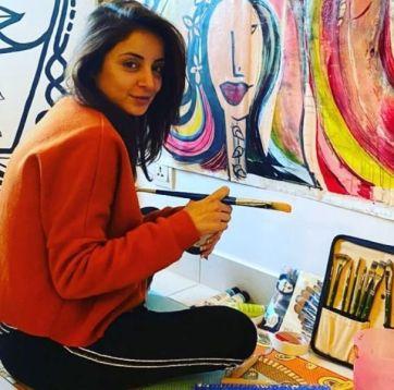 Sarwat Gilani painting a canvas