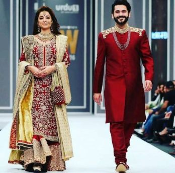 Sarwat Gilani walking down the runway with her husband Fahad Mirza for a bridal collection