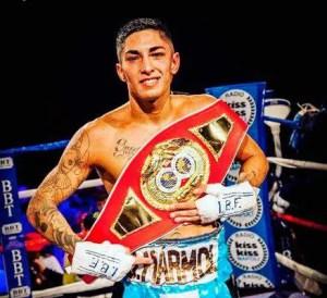 A photo Jeremias Ponce holding a title