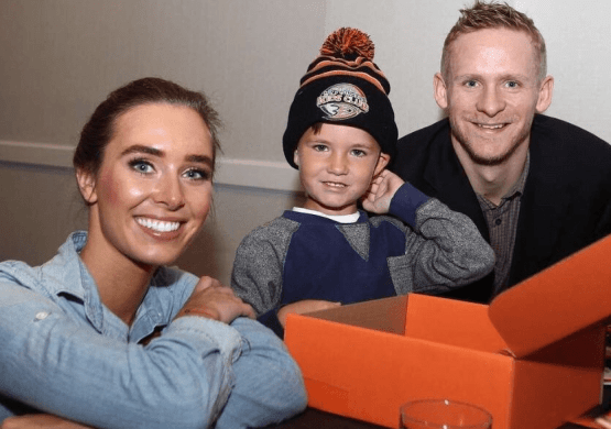 An Image of Corey Perry, his wife Blakney Perry and their son