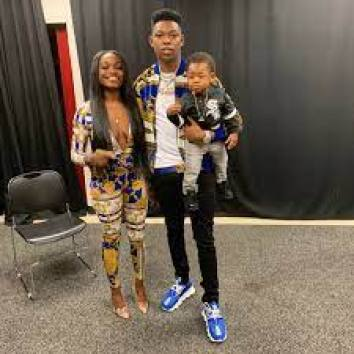 Image of Yung Bleu and her girlfriend and child
