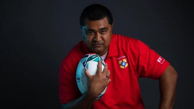 Toutai Kefu with a rugby ball