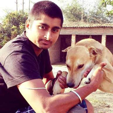 Deepak playing with Dog
