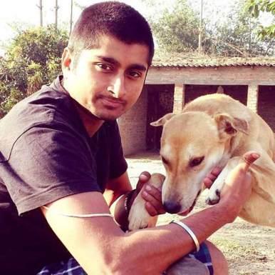 Deepak playing with Dog